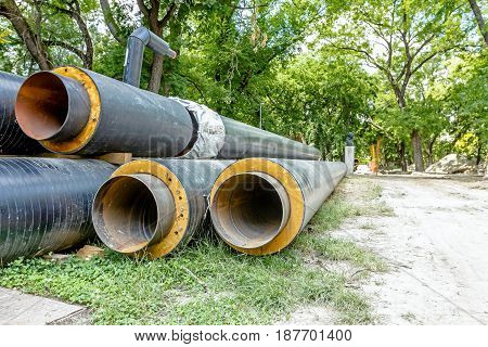 Piled coated heat pipes are waiting to be placed into the ground.