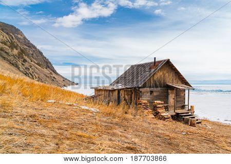 Log hut on the shore of Lake Baikal Russia