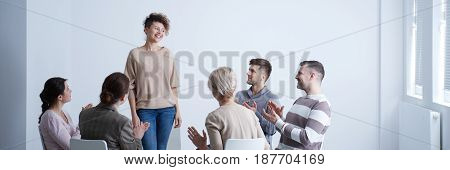 Rehab Group Applauding Happy Woman