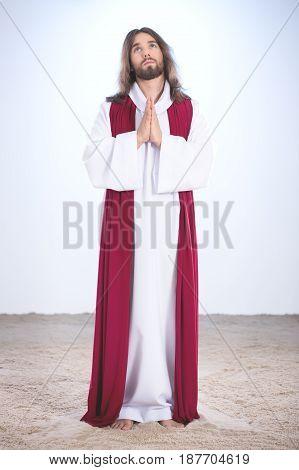 Jesus Praying On Sand