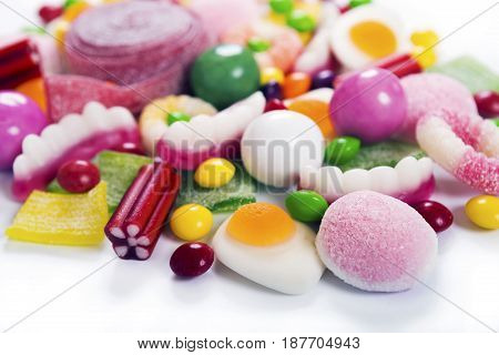 Colorful candies, jelly and marmalade on white background