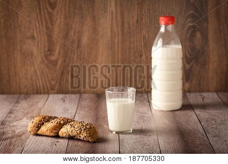Fresh Seedy Bread And Milk On Wooden Background