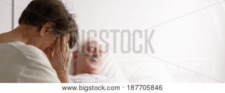 Senior Woman Visiting Her Sick Husband