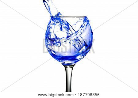 Purple Water Pours Into A Glass On A White Background