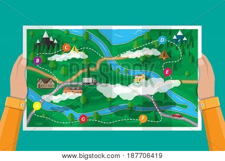 Hands with suburban paper map with houses with car, trees, road, river, mountain, sky and clouds. GPS and navigation. Village. Vector illustration in flat style