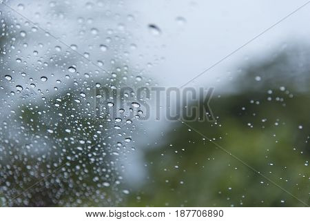 Water drops steam of rain on car windshield window glass after the rain