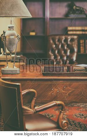 Rich vintage house with leather interior and a lamp on the table