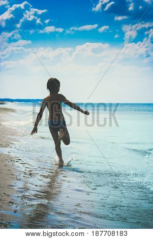Child Runs Along The Beach. Instagram Stylisation. 2