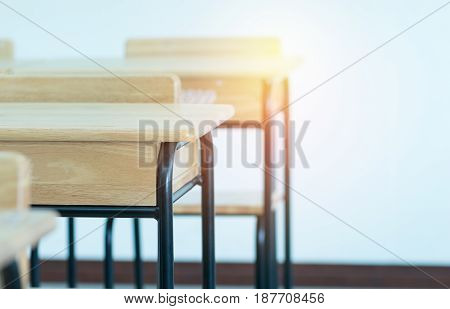 Empty School classroom with desks chair wood and blackboard in high school thailand vintage tone education concept