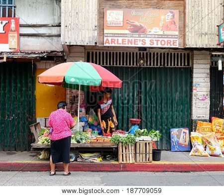 Selling Vegetables At Market In Manila, Philippines