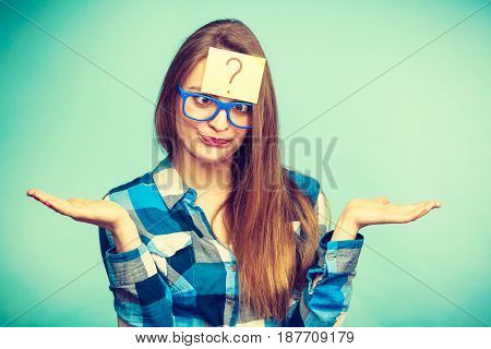 Thinking woman with big nerdy eyeglasses and question mark on forehead. Creating new idea studying and education concept.