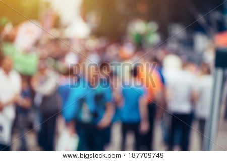 Blur defocussed crowd of people at public place such as street abstract background for general public or population opinion concept