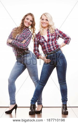 Generation and relationship. Full length adult daughter with mother. Two attractive casual style women long hairs blonde mom and brown haired girl posing in studio isolated