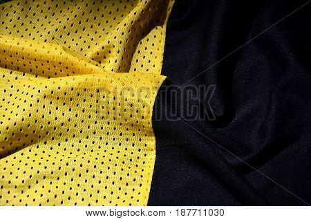 Yellow Sport Clothing Fabric Texture Background. Top View Of Yellow Cloth Textile Surface. Bright Ba