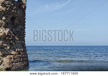 Ruin of tower emerges from the sea