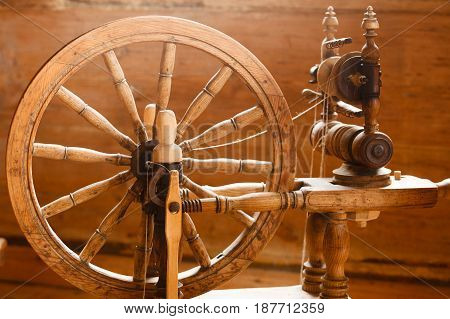 Traditional devices vintage tailoring equipment concept. Old fashioned wooden distaff spindle spinning wheel