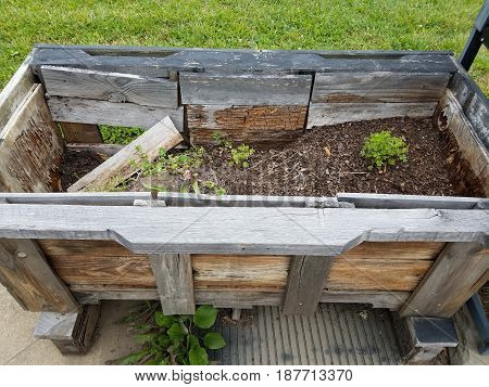 old and dilapidated wooden garden planter box