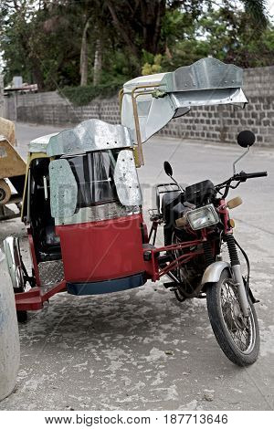 In Asia Philipphines The Typical  Motorbike