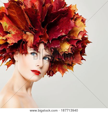 Autumn Beauty. Perfect Woman with Fall Leaves Wreath