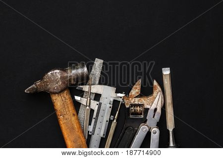 Working Tools On Black Background. Set Instruments For Hand Work And Fixing. Construction And Renova