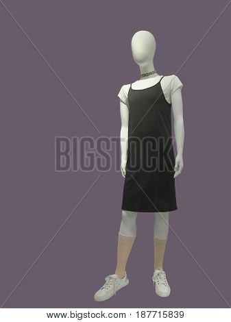 Full-length mannequin dressed in fashionable kids wear. Isolated on blue background. No brand names or copyright objects.