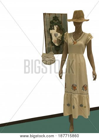 Full-length g female mannequin wearing beige dress and hat isolated. No brand names or copyright objects.