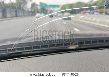 Perspective View Of Cracked Car Windscreen Or Windshield While Driving
