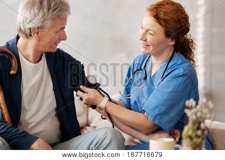 For neat measurements. Qualified experienced tender lady employing tonometer in her work while running a consultation and conducting some general tests