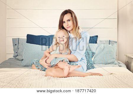 beautiful woman and babigirl 2 years old