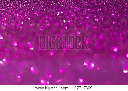 Abstract pink bokeh of lights on background