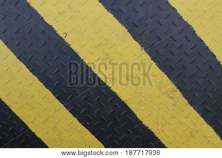 Black and yellow danger warning sign. Attention background