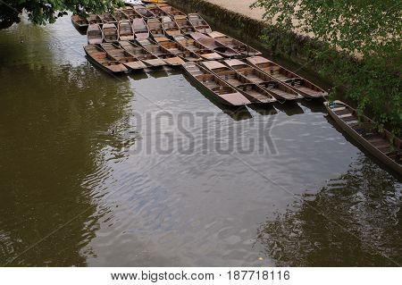 Punts in a canal in England on a spring summer day