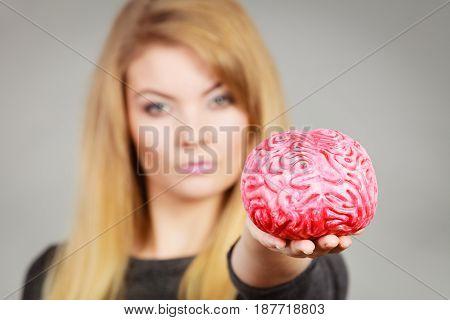 Woman Holding Brain Having Idea