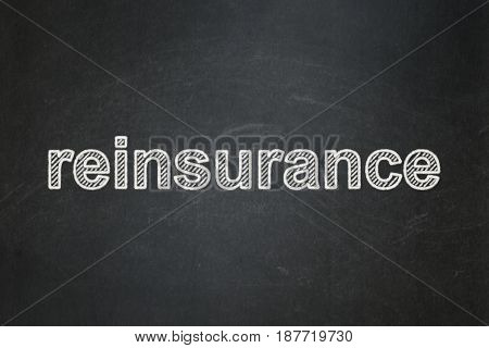 Insurance concept: text Reinsurance on Black chalkboard background