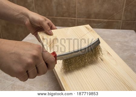 Grinding wood with a wire brush for further processing
