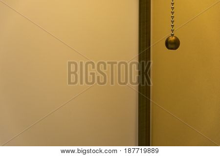 The room is a lamp with a gold chain switch
