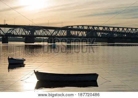 silhouette of the bridge over the Santa Lucia river at sunset in Uruguay