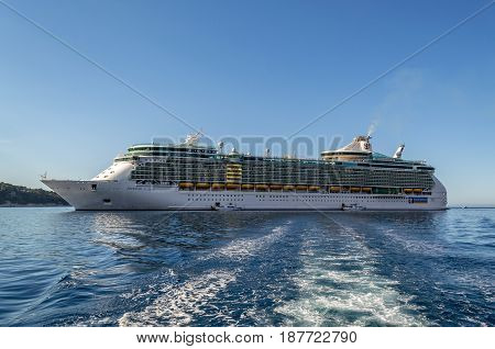 Freedom of the Seas - Villefranche, France - 09 May, 2017: Royal Caribbean International's cruise ship Freedom of the Seas anchored of the coast of Villefranche as tenders prepare to pick up passengers