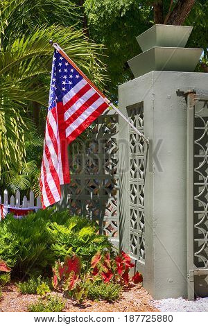 Fort Myers, FL, USA - 07/01/2016: American flag outside the Edison & Ford Winter Estates in Fort Myers FL for July 4th