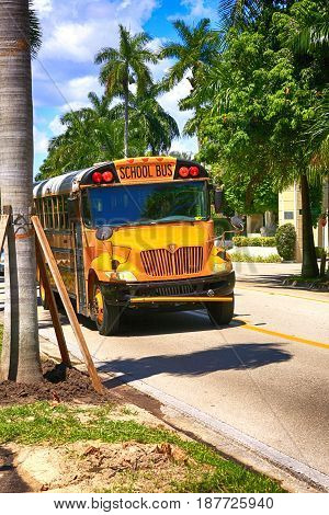 Fort Myers, FL, USA - 07/01/2016: Yellow School bus in the historic district of Fort Myers FL