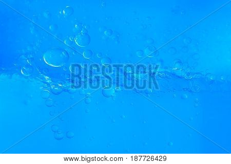 Blue Water With Bubbles On White Background
