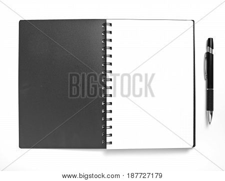 Blank spiral notepad and pen on white background