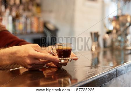 Female hand holding cup of coffee