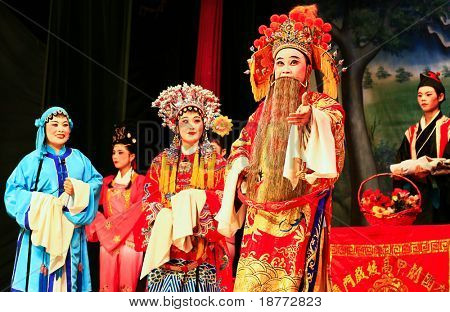 XIAMEN - APRIL 30: Actors of a traditional Chinese opera perform on stage in the province of China April 30, 2009 in Xiamen, China. Younger generations are not interested in this Chinese opera anymore.