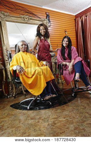 Women having hair done in beauty salon