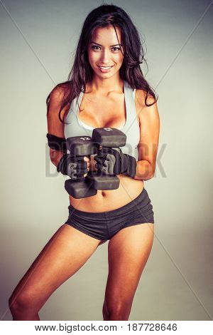 Exercising hispanic woman working out
