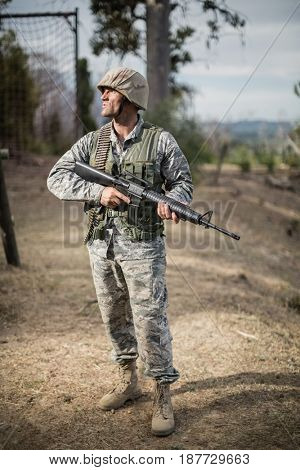 Military soldier during training exercise with weapon at boot camp