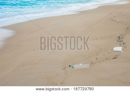 Plastic bottles and other waste on sea beach