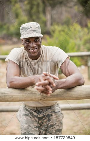 Portrait of military man standing during obstacle course in boot camp