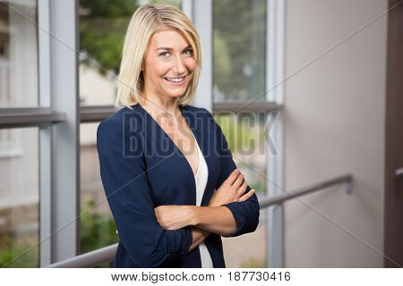 Portrait of businesswoman standing with arms crossed in the office